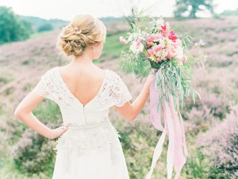 bride holding pink coloured bouquet