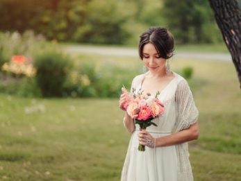 boho Bride holds wedding bouquet