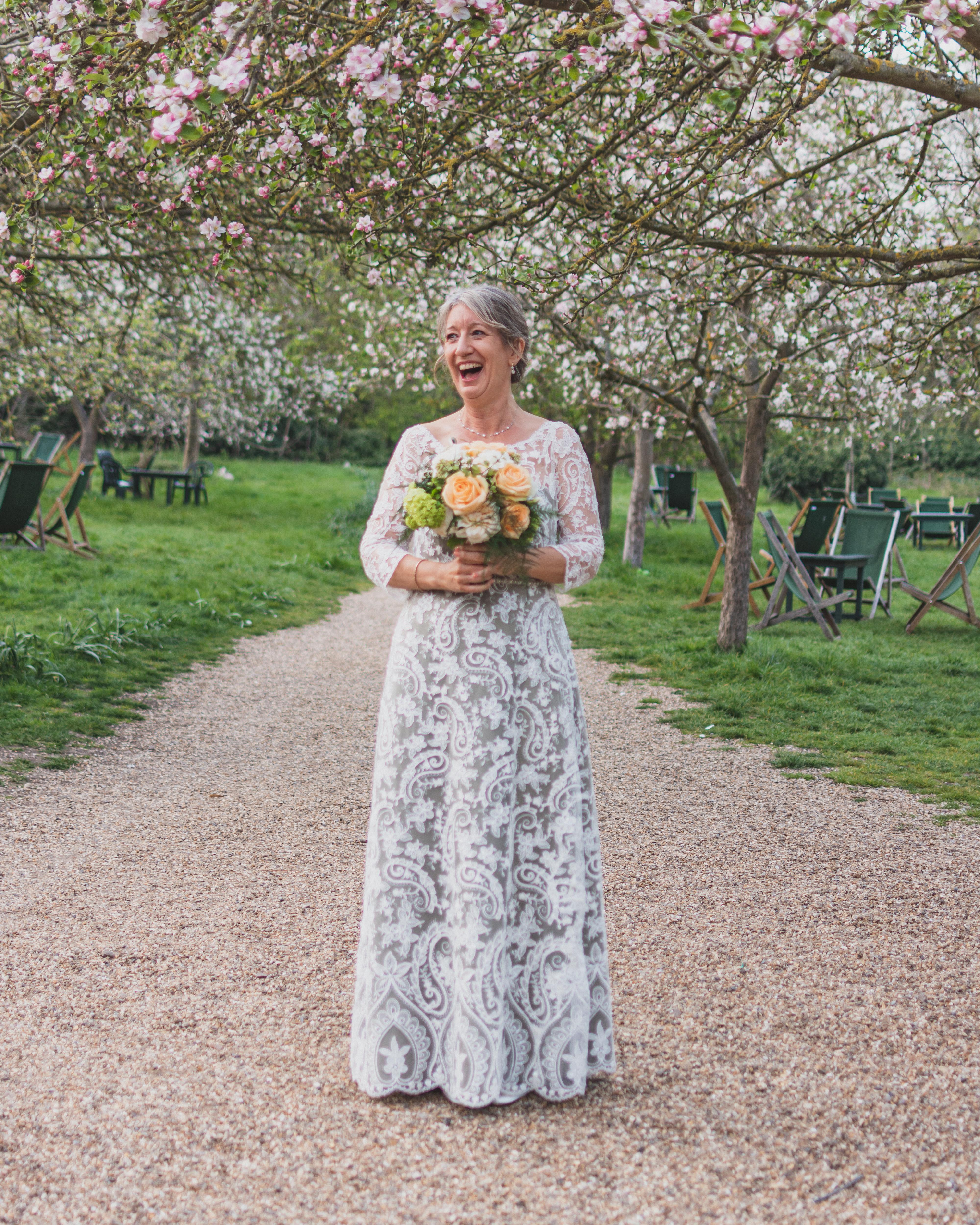 Bride on wedding day in lace wedding dress