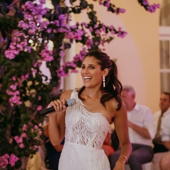 Bride wearing one shoulder wedding dress.